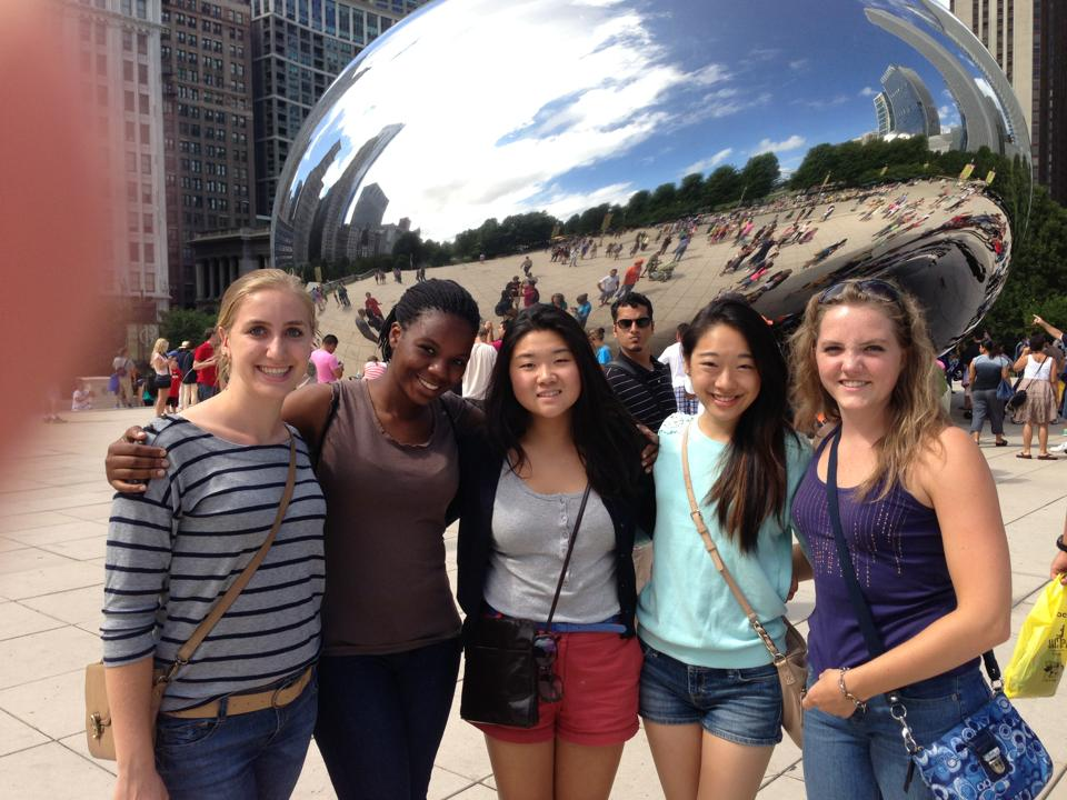 Alex poses with friends in her new city, Chicago.