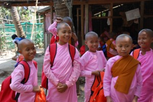 Several young Burmese girls are ready for the school day.