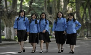 Several Chinese students in the their gender-specific summer uniforms.