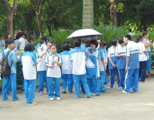 Several Chinese students in their gender neutral winter uniforms.