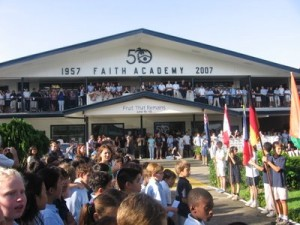 Students, in uniform, at Faith Academy, during their annual flag ceremony.