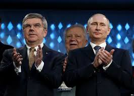 IOC President Thomas Bach and Russian President Vladimir Putin applaud while watching the closing ceremonies from Sochi.
