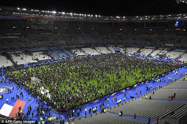 Fans attending the French and German soccer match are kept inside the stadium due to the Paris attacks (picture credit Daily Mail Online).