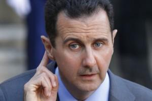 61606-syrias-president-bashar-al-assad-answers-journalists-after-a
