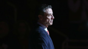 Somehow Louisville men's basketball coach Rick Pitino has escaped the situation unscathed after denying any knowledge of his team's recruiting violations. (photo courtesy Sporting News)