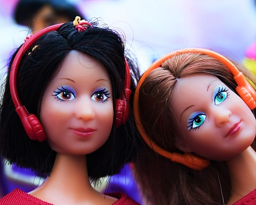 Two Barbie dolls with walkman and headphone